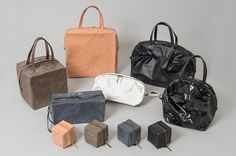 "NOUGAT Pleats Please ISSEY MIYAKE The name of the collection derives from the French soft candy ""nougat."" The bags are made from aluminum, and each bag can be shaped into the desired form just like clay."