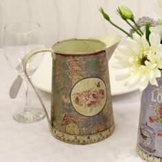 This stunning vintage rose metal jug is the perfect wedding decoration for your big day. Featuring a beautiful detailed rose design this zinc pot is the perfect table decoration for your wedding function. Place your beautiful flower arrangements inside of this vintage jug to create the perfect centrepiece at your big day. With an elegant vintage theme this vintage rose pot will also be handy at those afternoon tea parties, birthdays or celebrations.