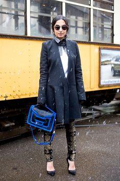 Milan Fashion Week 2013  Nausheen Shah, stylist  wearing a Balmain coat, 7 For All Mankind trousers, an Emporio Armani collar and a Pierre Hardy bag.