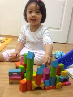 She likes to play block-stacking.