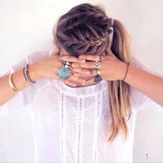love the hair, jewelry, and white cottony top.