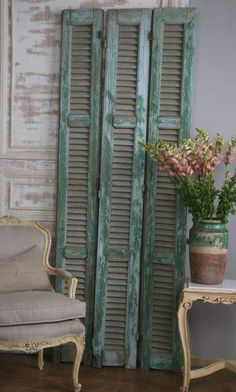 thevintagehome.net  / I brought some shutters home identical to these, from S.D.  Someone was throwing them away.