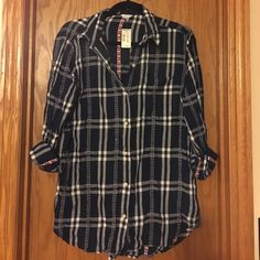 NWT button down flannel tunic from Aero NWT button down from Aero.  Hits about mid thigh depending on your height.  Sleeves are cuffed in photo but are full length.  Blue, white, red pattern.  Smoke free home. Aeropostale Tops Button Down Shirts