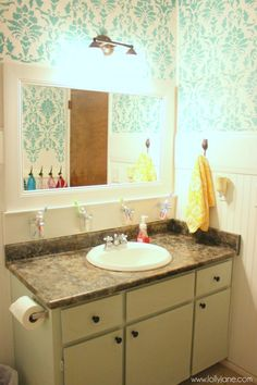 turquoise stencil bathroom for main bath. Like the idea of personal toothbrush and toothpaste holders for each kid.