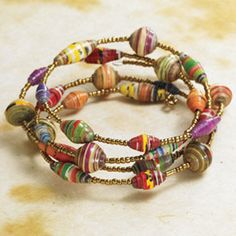 Rafiki Wrap Bracelet  Handmade in Kenya, this lightweight, lovely bracelet goes with anything and does good in the world. Each colorful bead is one of a kind, hand-rolled from recycled paper and sealed with waterproof lacquer. No two are exactly alike. The paper beads are strung with small golden seed beads on memory wire that wraps gently around the wrist. Sales allow women in Kenya to provide food, shelter, and clothing for their families and send their children to school, so every…