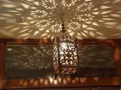 Moroccan lantern casting shadows