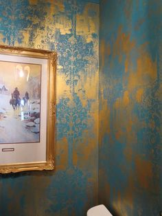 Bohemian and elegantly distressed and layer stenciled wall with the Modern Masters Metallic Paint Collection over a blue base   Modern Mastery series on the Cafe Blog on artist Theresa Cheek of Art's the Answer