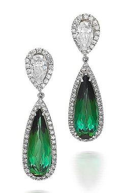 A pair of tourmaline and diamond earrings Each formed as an elongated pear-cut green tourmaline within a round brilliant-cut diamond surround, to an inverted pear-shaped surmount set with a pear-cut diamond within a round brilliant-cut diamond surround, mounted in 18k white gold, the tourmaline estimated to weigh approximately 11.36 carats in total, the diamonds estimated to weigh approximately 3.06 carats in total, earring length 4.4cm