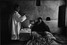 """CHINA. Shaanxi Province. 1994. The old Bishop of an """"Unofficial Church"""", Fan Yu Fei prays for people who are ill. Because he belonged to the """"Unofficial Church,"""" he was always under government surveillance. On April 22, 1992, he was suddenly and arbitrarily arrested and was locked up for 5 months. On April 5, 1995, he suddenly died of a heart problem while visiting a parish."""