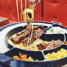 NEW RESTAURANT ALERT:  Jin Joo - SM Aura  A Korean restaurant serving favorites like samgyupsal baby back ribs with mozzarella cheese dip (pictured above) galbi jim and more  @catherine_mashiro # #bookymanila  View its exact location on our app!  Tag your friends who love Korean food