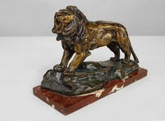 French Victorian bronze figure of lion on rouge rectangular shaped base (signed by FAZAM) Price $5,500.00