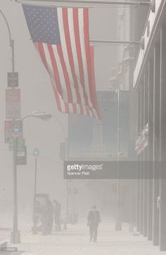 Dust swirls around south Manhattan moments after a tower of the World Trade Center collapsed September 11, 2001 in New York City after two airplanes slammed into the twin towers in an alleged terrorist attack.
