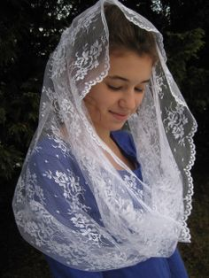 Elegantly framed with scalloped edging, the Infinity Veil's sheer lace hints of floral loveliness. For full coverage or framed around the neck like a scarf, this delightful veil will be a timeless piece for the adorer. $28