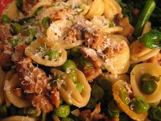 Orecchiette with Hot Italian Sausage  I found this recipe online last night, and Mark helped (really did most of it) me make it tonight for dinner.  I wasn't sure if I'd like it, but had hot Italian sausage in the fridge to use up, and didn't want your standard red sauced meal.  This fit the bill and was surprisingly delicious!! Ours didn't look so visually appealing, but it was tasty, definitely one we'll make again in the future.