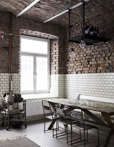 Check out the subway tiles with the brick!