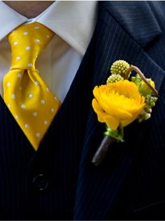 Well dressed groom with yellow polka dot tie and yellow rose boutonniere www.jevelweddingplanning.com
