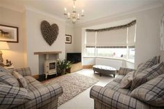 Cosy contemporary country living room with tartan check chairs. Why not head on over to join our FREE interior design resource library at www.FlorenceAndFreya.com?