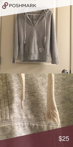 Aerie fit Grey pullover hoodie Heather grey pullover hoodie with front kangaroo pocket. Good condition, only worn a few times, except one of the ties is frayed, see picture #2. aerie Tops Sweatshirts & Hoodies