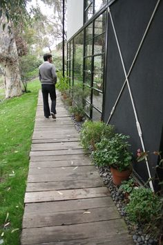 A Day In the Life Of: Eames House, Pacific Palisades.   Stones and potted plants.
