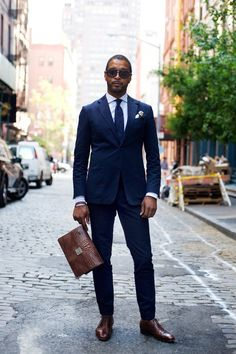 Classic tailored navy suit. Impeccable!