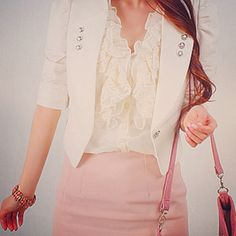 Mixing a pastel knee length skirt with a feminine top for a great business outfit