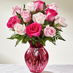 Includes one dozen light and hot pink roses hand-crafted and designed in a beautiful keepsake pink glass vase.
