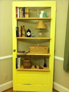 Corner bookshelf made out of storm door