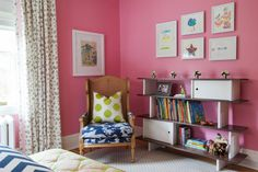 Bright, bold patterns are a playful pairing with the cotton candy pink walls in this girls bedroom. They temper the hue and keep it from overwhelming the space.
