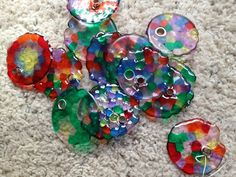 You don't have to have a drill! Pony Bead Suncatchers with a Rivet in the middle.