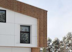 Oslo Norway apartment complex by Various Architects. White and wood facade with playful windows. Modern Architecture, Norwegian Architecture /  Oslo leilighetskompleks av Various Architects AS. Hvit og trefasade med lekre vinduer. Moderne arkitektur. Norsk Arkitektur.