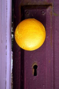 :) purple door, yellow doorknob