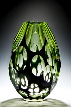 'Uovo' by Rony Plesl, blown uranium glass with black overlay, cut and polished surface.