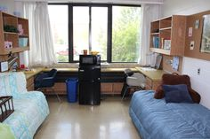 Standard Double Room: includes two beds with twin mattresses, two closets with hanging rods, two vanity mirrors with lighting, two dresser drawer sets, two desks with overhead lighting, two mounted wall shelves, a micro-fridge set and two desk chairs.