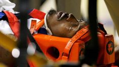 """""""Gerald Wallace #3 of the Charlotte Bobcats is strapped to a gurney after suffering a concussion from a hit to the face by Mikkie Moore in 2008 """" Streeter Lecka/Getty Images"""