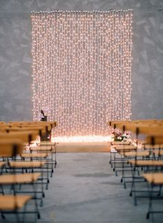 Top 10 Wedding Backdrop Ideas -  Lighten the Mood: If you'd like a contemporary look, use lights to create a modern backdrop. String lights are a great way to embellish your altar while still having a clean and crisp appearance. For an evening outdoor wedding, use globe lights for a softly lit ceremony that will transition seamlessly into your reception. Photo from Green Wedding Shoes // Braedon Flynn.
