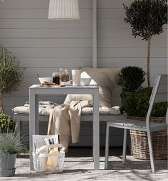 A groaning FALSTER dining table on a summer morning.