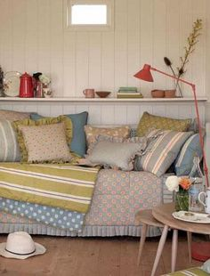 Create a country cabin  Country style has moved on from shabby-chic rose patterns and loose linen covers - the latest look is a quirky country cabin trend, filled with Fifties furniture and vintage accessories. Instead of a sofa, buy a day bed, for a relaxed, outdoorsy feel. Cover it with throws and cushions in duck egg blue, chartreuse green and coral - this is country at its most colourful.