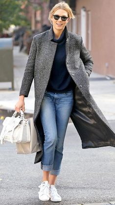 Karlie Kloss in a gray tweed coat, jeans, and white sneakers