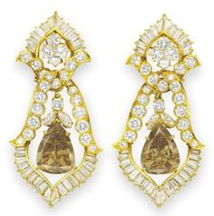 The Burton Cognac diamond earrings. Van Cleef & Arpels, 1974.   Elizabeth Taylor collection, Christie's.