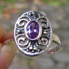 FINAL! REAL Sterling Silver Filigree Amethyst ring BRAND NEW!! NEVER USED.  Real, Solid 925 Sterling silver  Stamped 925 and also tested  7x5mm oval Lab created Amethyst  Feb. birthstone  2 tiny Maracasite stone accents  Brand new without tags, never worn  Vintage-style look  Size 8  rest assured that MY jewelry all is REAL IF called solid sterling or solid gold! I deal with jewelry all the time and test everything. :) Jewelry Rings