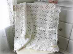 This is a PATTERN ONLY for a baby blanket (afghan, christening shawl) in lace design made with light worsted (category 3) yarn and size G/6 (4.25 mm) crochet hook.  The finished blanket measures approximately 37 by 31 inches. The skill level is beginner. The stitches used are: chains, single crochets, double crochets, and slip stitches. The pattern is written in English, using the US crochet terminology. This pattern is my original design and it cannot be redistributed. However, you have...