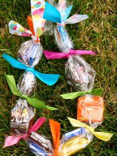 Candy lei's for kids summer party! Very clever and cuter than just traditional treat bags!