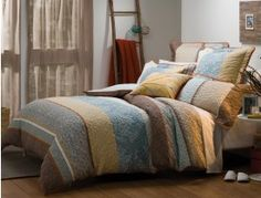 Inspired by traditional Japanese kimono designs, the Misaki quilt cover will add a touch of understated elegance to your bedroom. The warm ochre hues and soft blossom prints combine with calming blue panels to create this serene design. Traditional Japanese Kimono, Single Quilt, Kimono Design, Quilt Cover Sets, Queen Quilt, Bed & Bath, Bed Spreads, House Colors, Home And Living