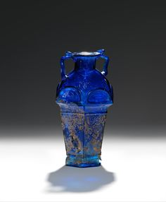 Glass hexagonal amphoriskos. Signed by Ennion the Glass Maker. Period: Early Imperial, Julio-Claudian. Date: 1st half of 1st century A.D. Culture: Roman