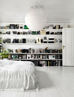 The way the bookshelf has been styled in this bedroom, together with the otherwise monochrome decor, make for an entire wall that looks like a piece of art.