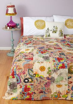 All in a Day's Patchwork Quilt. Today found you hopping from meeting to meeting with a ton of work in between, so once youre home you happily cuddle up on the couch to unwind beneath this patchwork quilt from Karma Living! #multi #modcloth