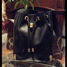 Vince Camuto bag In great condition black with gold hardware Vince Camuto medium shoulder bucket bag. Vince Camuto Bags