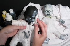 Turn normal-looking creepy baby dolls into dark terrible creepy baby dolls by painting them black and gray with a makeup sponge. Super easy, and sure to scare someone out there. Just throw these all around your house for people to find where they won't notice. In the bathroom, in closets... everywhere!