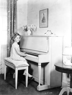Shirley Temple playing piano,1935.