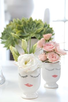 The Celfie Vase with a cheerful painted face makes a happy home decor gift idea.